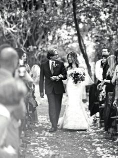 The bride is escorted down the aisle by her father. #weddings