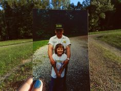 Dear Photograph, Dad is gone…but the strength of his arms will always be around us. Holly