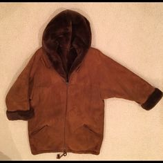 Marni Suede Shearling Fur Hooded Parka Toasty! Marni Chocolate Brown Suede Shearling Parka style gas coat Size 40 approx US 6/8 Minor imperfections, slightly worn on one elbow, tiny black mark on back near bottom Hard to photograph, contact me if they don't show up on your screen Turn back cuffs Drawstring bottom hem Hip slash pockets zip closed Made in Italy Comes in Marni garment bag Marni Jackets & Coats