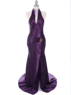 This gorgeous evening dress features halter neck with low v neckline. Draped detail at hips with a dazzling jeweled brooch. Long skirt is slit alluringly up the side. Slight train. Beautiful and el ..