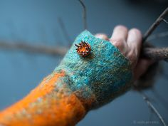 Felt arm warmers in fire orange and teal turquoise blue with handmade embroidered button - so stylish accessory for your outfit!  These stylish hand warmers / fingerless gloves are hand felted...