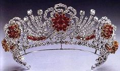 The Burmese Ruby Tiara  Info: A tiara from the collection of Queen Elizabeth II. It was created from diamond of the Nizam of Hyderabad tiara and rubies she was gifted by the people of Burma as wedding present. It is shaped in the form of Tudor roses. Stone(s): Diamond, Ruby
