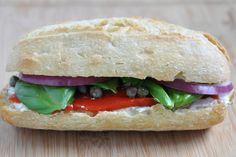 Goat Cheese & Roasted Red Pepper w/Red Onion, Capers & Basil Leaves
