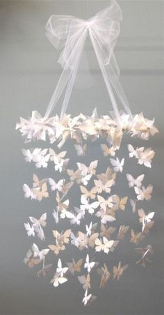 Pretty DIY paper mobile for baby girl's nursery. Paper butterflies, ribbon/tulle, fishing line.