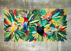 the mural replicates the lush and diverse assortment of botanical and animal life found in a rainforest environment.