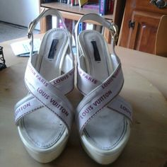 """Louis Vuitton White Wedge Platforms Sale! Run Small: Say Sz. 39, but more like 1/2 sz. small, so an 8.5 Some dark green marks on top straps, you really cant tell when wearing them though, small. See pic 3. Platform @ toe: 1 & 1/2"""" & @ heel 4 & 1/2"""". Fuschia lettering on straps. No box, as I got them used. no dust bag. Too small for me. #CA1027 Just looked at them today. Platform parts starting to yellow. Still gorgeous & super luxurious pair of sandals to wear w/a beautiful dress! new…"""