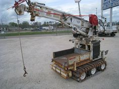 DIGGER:   2004 SDP IMT, Model EZH22H, 283 Hours,  Has Remotes, Auger, Pin on Bucket,  2,500 LB. Capacity,  2 Kelly Bars,  Detachable Drill Motor.