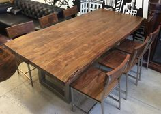 Kai Dining Table is made of acacia wood in hand distressed finish, and U-shaped metal legs. The table is perfect for large dining spaces and seats up to 10 persons.