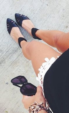Black and white for summer done with black shoes and white eyelet shorts.