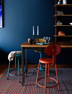 Blue turquoise red wood in table vignette via Ashley Capp   Love the colors in this space...