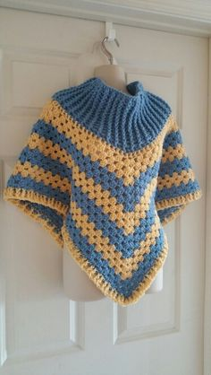 Hot Off My Hook! Project: Cowl-Neck Poncho Started: 29 Oct 2015 Completed: 01 Nov 2015 Model: Madge the Mannequin Crochet Hook(s): 7mm, Cowl portion J, Granny Stitch Yarn: Redheart With Love, Redheart Super Saver Color(s): Bluebell, Cornmeal Pattern Source: Simply Crochet Magazine Issue No. 25 Pattern Designed By: Simone Francis Notes: This is my 43rd Cowl-Neck Poncho! It is a Christmas gift for one of my Son's coworkers!