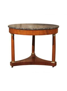 Empire is the sought after era these days. This wonderful gueridon is made of mahogany veneer and has beautiful bronze fittings adorned with an intricate design.  || TheHighBoy || #highboystyle #antiquesmakeitbetter #antiques #vintage