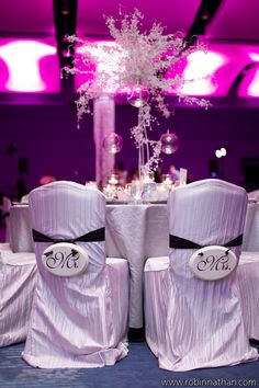Mr & Mrs Chair decor.  Sparkly centerpiece.  Venue ~ Georgia Aquarium. Photo courtesy of Robin Nathan.