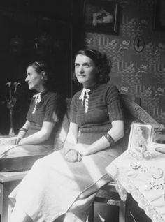 A Jewish woman living in hiding as a Christian, sits by a mirror in her apartment in Brussels. Pictured is Leah Ciechanow. She was subsequently deported to her death in Auschwitz along with her son.