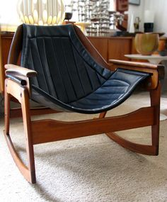 JERRY JOHNSON Mid Century Danish Modern sculptural lounge rocking chair sling rocker black upholstery wood Eames Wegner Mad Men '60s rare. $2,985.00, via Etsy.