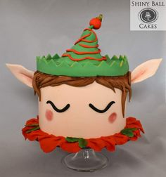 With this elf on the shelf, er, cake stand, everyone will be happy! :) Taking the unicorn cake trend, I created a happy Christmas elf using fondant accents. Christmas Themed Cake, Christmas Cake Designs, Christmas Cake Decorations, Christmas Cupcakes, Christmas Sweets, Holiday Cakes, Christmas Elf, Holiday Treats, Christmas Baking