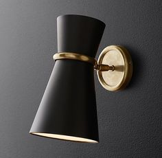 RH Modern's Blair Sconce:Matte-black hourglass shades cast light both upward and down in our Blair collection from American designer Aerin. Inspired by the tailored looks of 1950s lighting, it is a refined source of ambient illumination.