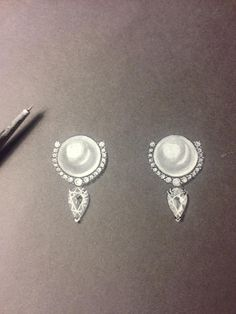 Hand rendered Pearl and diamond earringd