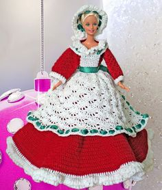 The Mrs. Claus doll is an original creation of Gaylee's Dollhouse. The gown is created with red cotton crochet thread and trimmed with white. Her apron and bonnet are made of white crochet thread and trimmed with a green satin ribbon.  This costume is completed with a ribbon in her hair, a petticoat and shoes.