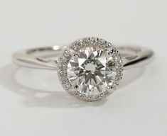 Center diamond if you're a bit slow today) with beautiful, sparkling smalle Small Engagement Rings, Beautiful Engagement Rings, Halo Engagement, Felt Case, Halo Setting, Girly Things, Girly Stuff, Vintage Modern, Wedding Rings
