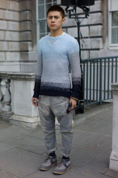 Soft pale blues and washed-out greys for men . Street shot, London Fashion Week