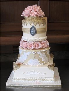 """I do not like the colors or even the """"broach"""" on the front, but the lace and roses are pretty and fit your theme. Vintage Wedding Cake"""