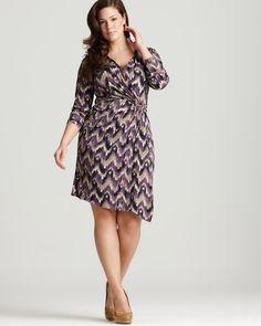 Plus size Faux wrapp dress -   Crossover v neck, long sleeves  Inset elasticized waist, gold-tone logo clasp closure