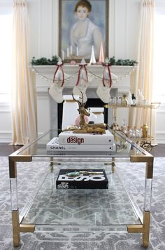 ELTE Brass and Lucite Coffee Table, coffee table styling, Circa Lighting Paris Flea Market Chandelier, grey rug, elegant living room design, DIY christmas decor, feminine and sophisticated, Christmas mantel