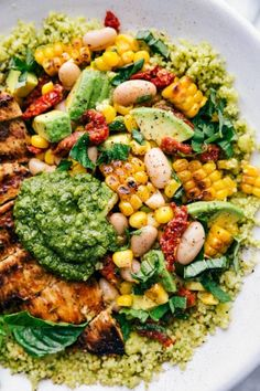 Delicious pesto chicken bowls with lemon chicken an avocado corn salsa and plenty of pesto This easy dinner recipe is made with nutritious ingredients and whips together. Pesto Pasta Recipes, Couscous Recipes, Pesto Recipe, Chicken Recipes, Recipes Using Pesto, Sundried Tomato Recipes, Pesto Dishes, Sundried Tomato Chicken, Healthy Pesto