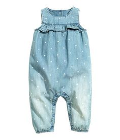 Denim blue. Sleeveless jumpsuit in soft, washed denim with a printed pattern…