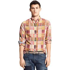 Tommy Hilfiger men's shirt. Yarn-dyed for brilliant color, our plaid shirt is the perfect complement to this season's slim chinos and skinny jeans. Roll the sleeves to expose the contrast cuffs.<br/>•New York fit (our slim silhouette, cut sleek through the chest and shoulders). <br/>•Button down, microflag on cuff.<br/>•100% cotton.<br/>•Machine washable.<br/>•Imported.<br/>