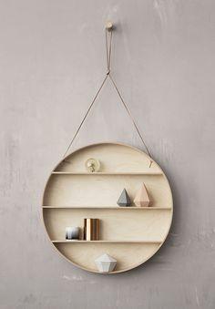 shallow round hanging wall shelf