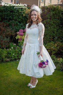 Short pleated wedding dress with Chantilly lace bolero