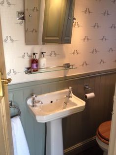 downstairs loo Farrow and Ball Pigeon on wood panelling. Downstairs Cloakroom, Downstairs Toilet, Small Toilet Room, Small Bathroom, Bathroom Sinks, Wood Panel Bathroom, Seaside Bathroom, Bathrooms, Boho Bathroom