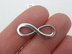BULK 50 Infinity charms or connectors 23 x 8mm antique silver tone