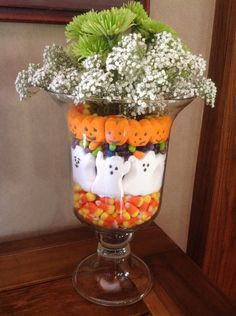 Decorating with Ghosts…or…Hello October! Halloween Decorations: The perfect Fall/Halloween companion to the Halloween ghost cake, made with Peeps Ghosts and Pumpkins, also Jelly Beans and candy corn. Halloween Flowers, Halloween Ghosts, Halloween Candy, Holidays Halloween, Halloween Crafts, Halloween Decorations, Halloween Ideas, Happy Halloween, Halloween Centerpieces