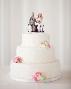 A cream-cheese pound cake with lemon filling was topped with figurines, including the couple's three dogs