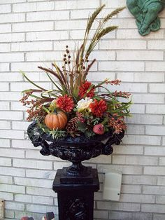 Fall floral urn - it was gold (yelch) and I painted it black and added a few floral stems from JoAnn Fabrics.  THRILLED!