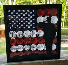 This Fourth of July shadow box is beautiful. Featuring a saluting soldier, vinyl words and rolled flowers, this shadow box is sure to be treasured. Items needed: Cricut machine, paper, vinyl. Fourth of July shadow box Flower Shadow Box, Diy Shadow Box, Flower Boxes, Vinyl Projects, Diy Projects To Try, Crafts To Make, Craft Projects, Craft Ideas, Fun Ideas
