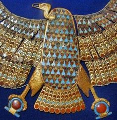 "*EGYPT~KV 62 Tutankhamen: This collar is the vulture of Upper Egypt Empire goddess Nekhbet represent+lay on the chest of the mummy,so that the tips of vulture wings reaching to the shoulders of the mummy.A counterweight in flower shape hung-w/gold wires to lugs attached to the back of the vulture wings-down on the back of the mummy.Both raptors talons holding the "" 's characters"" ,the hieroglyphs for ""infinity"" w/ deposits of red and blue glass."