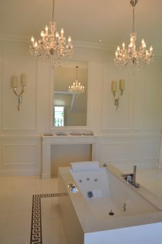 Ivory classical bathroom with marble and chandeliers