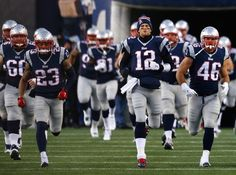FOXBORO, MA - JANUARY 10: Tom Brady #12 of the New England Patriots runs onto the field with teammates before the 2015 AFC Divisional Playoffs game against the Baltimore Ravens at Gillette Stadium on January 10, 2015 in Foxboro, Massachusetts. (Photo by Jim Rogash/Getty Images)