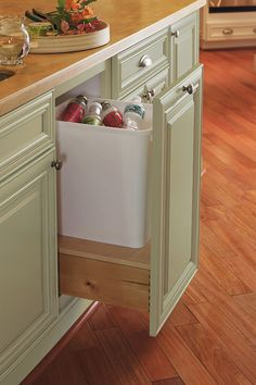 Our Waste Basket Cabinet has a 50 quart bin that provides the perfect space to get rid of recyclables or waste.