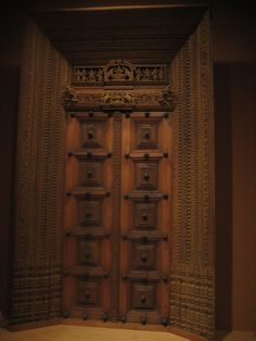 Artistic Oversize Front Teak Doors with Carving