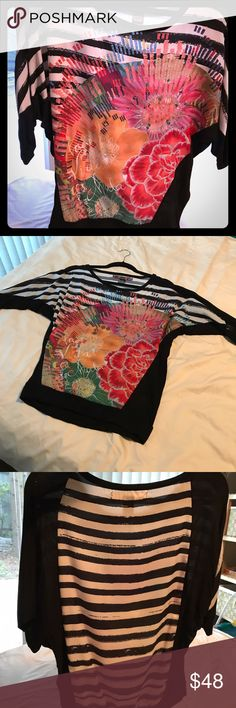 Embellish Graphic Blouse by Desigual Bright and colorful is the trademark of Desigual. The graphic pattern is a silky Viscose blend and the black detail is a knit. Always just a little tight (it's a small small). Great with jeans, black skinny trousers or a jean skirt or shorts. Desigual Tops Blouses