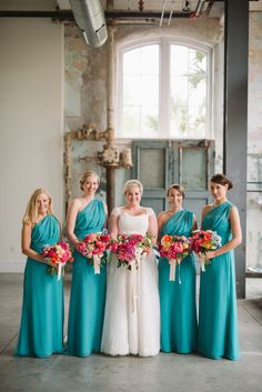 teal bridesmaid dresses with pink bouquets | Joshua Aaron