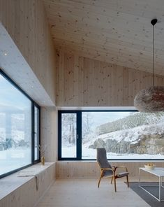 observing nature from a huge bench around the inside of your house.Villa Öjersjö: A Contemporary Black Wooden House by Bornstein Lyckefors arkitekter - Design Milk