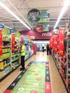 Carlsberg In Store - giant World Cup 2014 floor sticker, as seen in Asda and supported by several brands.