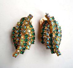 KRAMER Green Rhinestone Earrings, Aurora Borealis, Leaf Motif, Signed Vintage by RenaissanceFair on Etsy https://www.etsy.com/listing/259002000/kramer-green-rhinestone-earrings-aurora