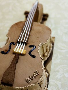 This is a very cool violin cake! I don't know which board it should go on, Amazing cakes or music??
